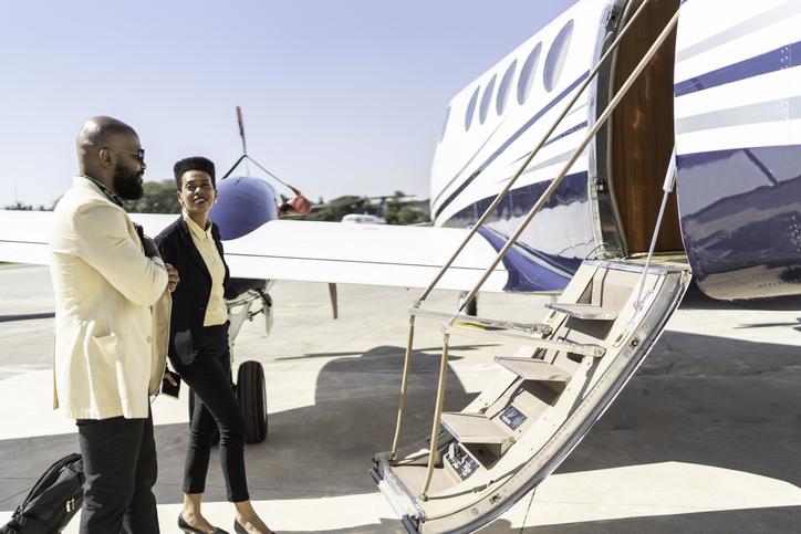 jet cars members boarding a flight